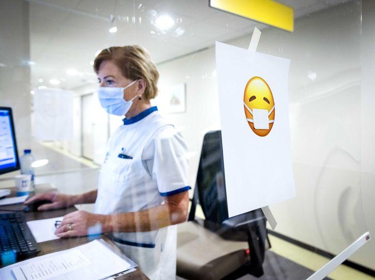 Verpleegkundige aan het werk. Beeld ANP