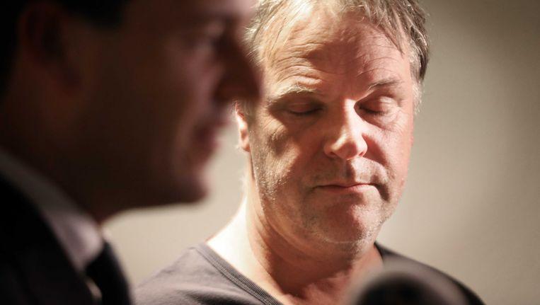 Lodewijk Asscher en Hans Spekman vrijdagavond tijdens de persconferentie in Amsterdam. Beeld anp