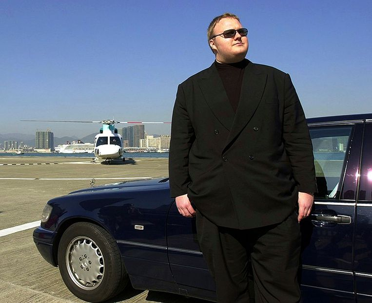German Internet millionaire Kim Schmitz poses beside a car in Hongkong in this 1999 file photo. New Zealand police broke through electronic locks and cut their way into a mansion safe room to arrest the alleged kingpin of an international Internet copyright theft case and seize millions of dollars worth of cars, artwork and other goods. German national Schmitz, also known as Kim Dotcom, was one of four men arrested in Auckland on January 20, 2012, in an investigation of the Megaupload.com website led by the U.S. Federal Bureau of Investigation. REUTERS/Handout (CHINA - Tags: CRIME LAW SCIENCE TECHNOLOGY POLITICS BUSINESS) FOR EDITORIAL USE ONLY. NOT FOR SALE FOR MARKETING OR ADVERTISING CAMPAIGNS Beeld Reuters