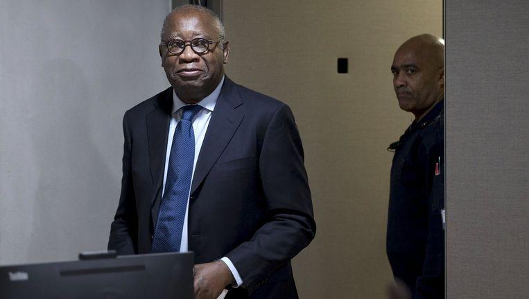 Laurent Gbagbo bij de start van zijn proces. Beeld REUTERS