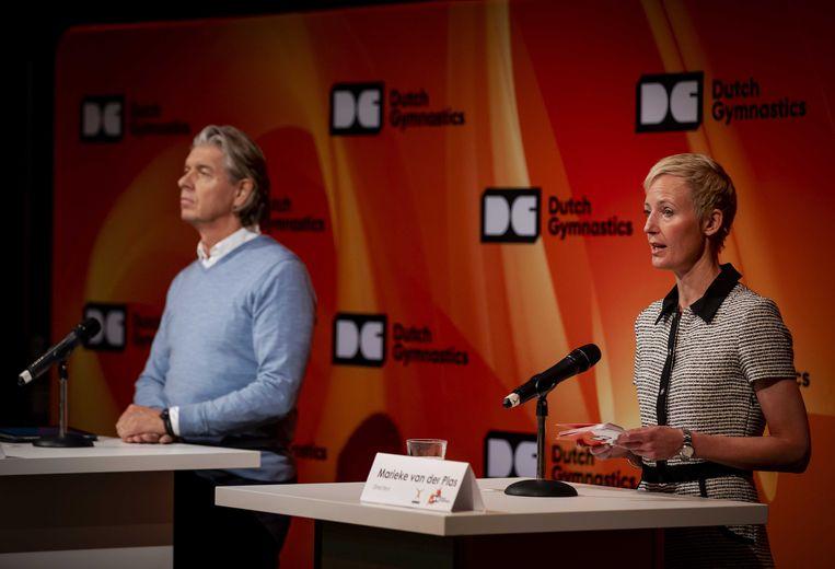 Technisch directeur van KNGU Mark Meijer en directeur van KNGU Marieke van der Plas tijdens een informele update op Papendal.  Beeld ANP