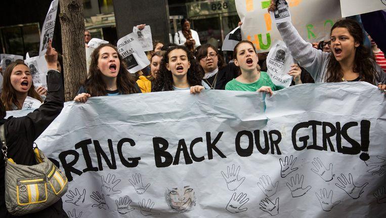 Studenten in de VS protesteren voor het consulaat van Nigeria tegen Boko Haram. Beeld afp