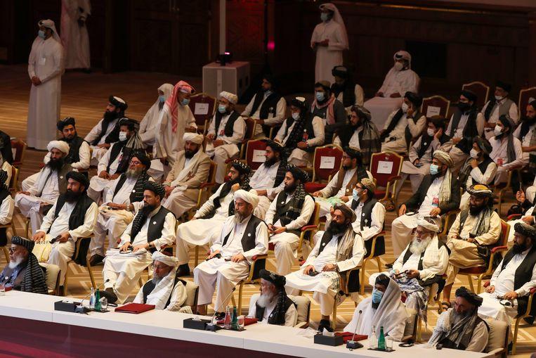 Leden van de delegatie van de Taliban tijdens de openingsceremonie van de onderhandelingen.   Beeld Hollandse Hoogte / AFP