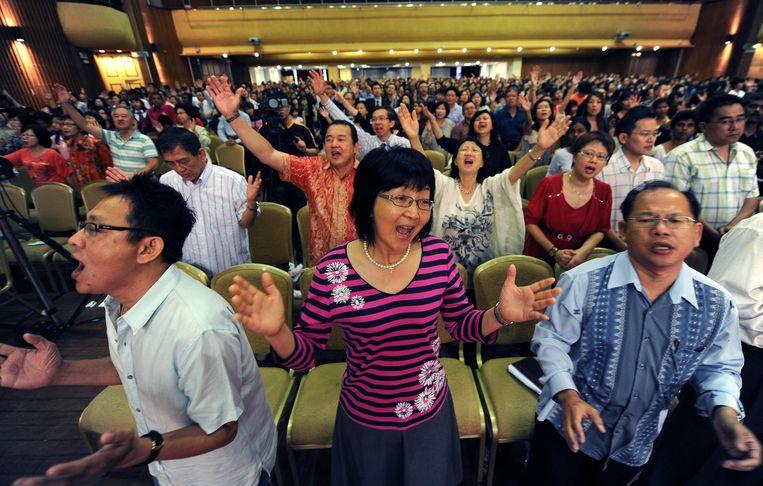 Maleisische christenen tijdens een kerkdienst in Kuala Lumpur. Beeld AFP