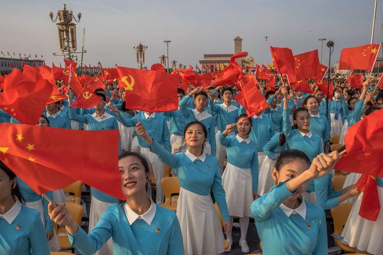 Een repetitie voor de viering van het honderdjarige bestaan van de Chinese communistische partij. Beeld EPA