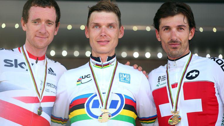 Het gedroomde podium: goud voor Martin, zilver voor Wiggins en brons voor Cancellara Beeld GETTY