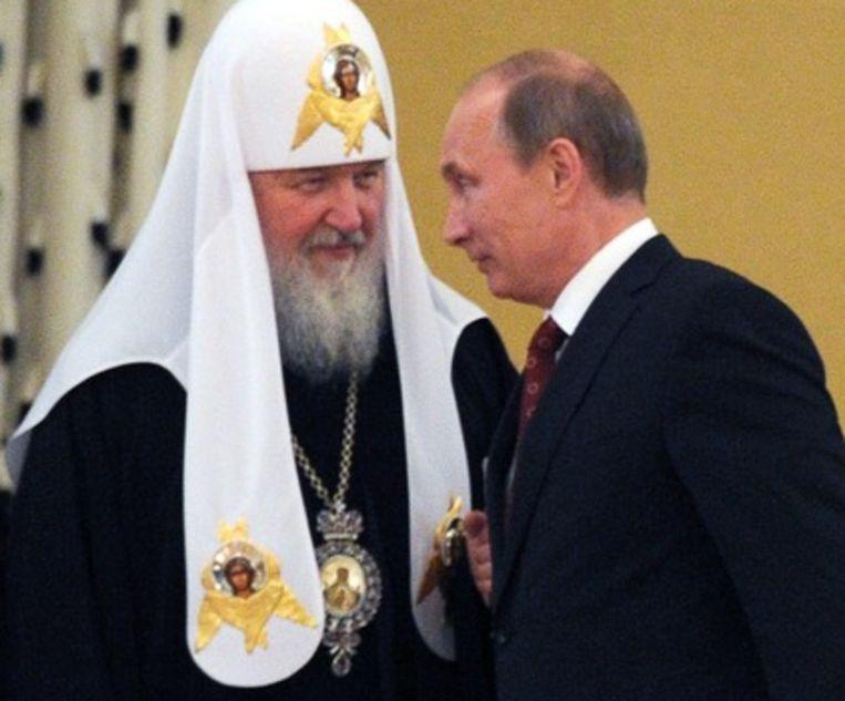 Patriarch Kirill (l) van de Russisch-Orthodoxe Kerk en president Vladimir Poetin. Beeld epa