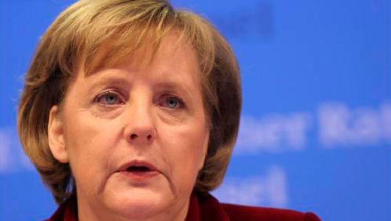 De regering Merkel wil tot 2014 maar liefst 80 miljard euro besparen. Beeld UNKNOWN