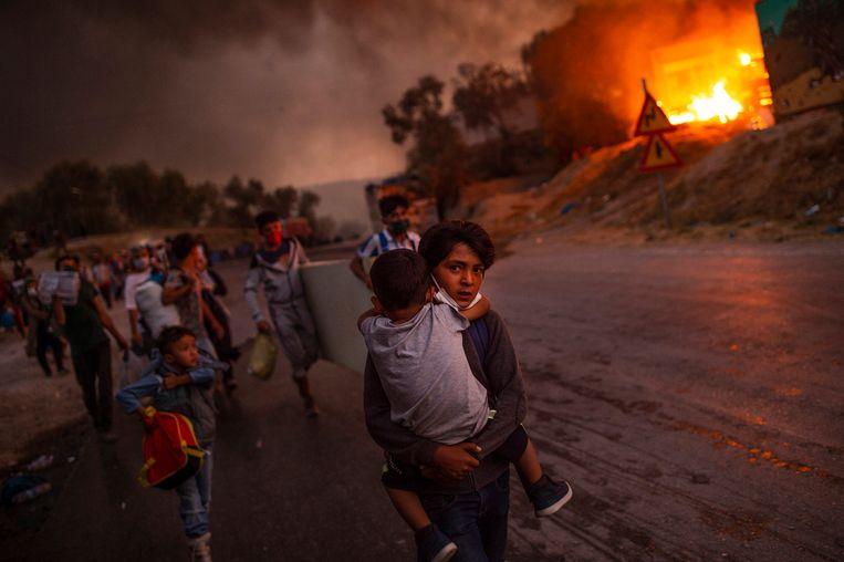 De verwoestende brand in Moria leidde ertoe dat het kabinet honderd slachtoffers op zou halen. Beeld EPA