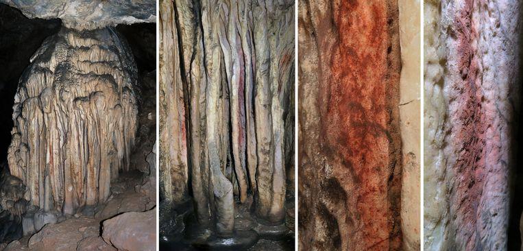 Rood okerpigment op stalagmieten in de Spaanse grot Ardales. Beeld AFP
