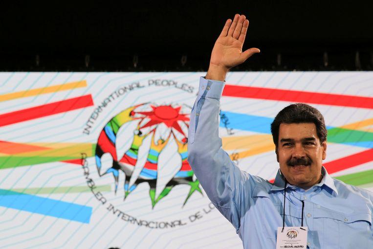 De Venezolaanse president Nicolas Maduro is verwikkeld in een machtsstrijd met de zelfverklaarde interim-president Juan Guaido.  Beeld REUTERS
