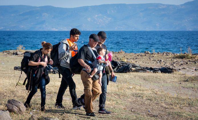 Beeld ter illustratie: Syrische vluchtelingen komen aan op het strand bij Eftalou.