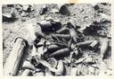 Duitse granaten en hun verpakkingen, gefotografeerd nadat wegtrekkende Duitse soldaten een deel van het munitiedepot in Hoog Soeren hadden laten ontploffen in de nacht van 16 april 1945. Rond het depot worden iedere maand nog explosieven geruimd door de Explosieven Opruimingsdienst Defensie (EOD).