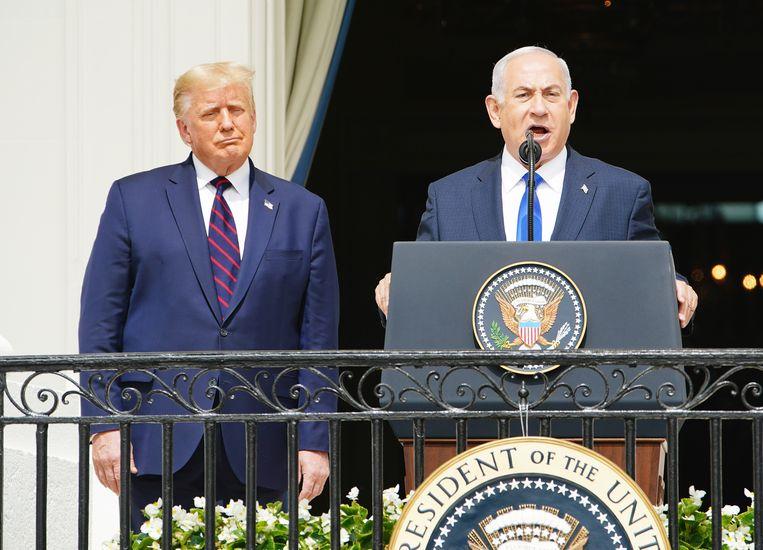 Donald Trump en Benjamin Netanyahu tijdens een staatsbezoek aan de VS in september vorig jaar. Beeld EPA