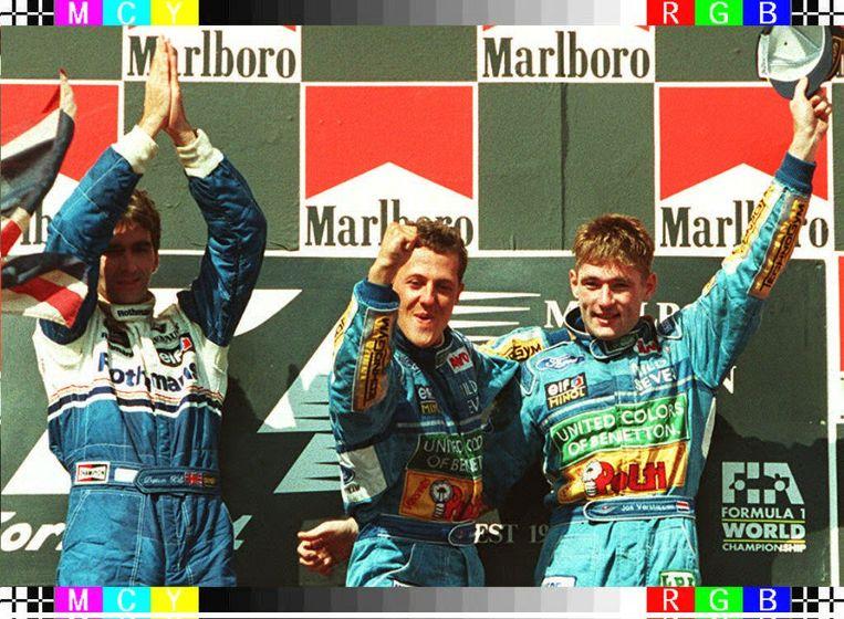 Damon Hill, Michael Schumacher en Jos Verstappen na de Grote Prijs van Hongarije in 1994. Beeld BELGA
