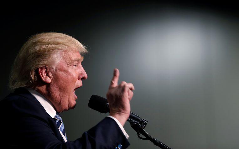 Donald Trump deinst er niet voor terug de spreekwoordelijke knuppel te hanteren als hij wordt uitgedaagd. Beeld REUTERS