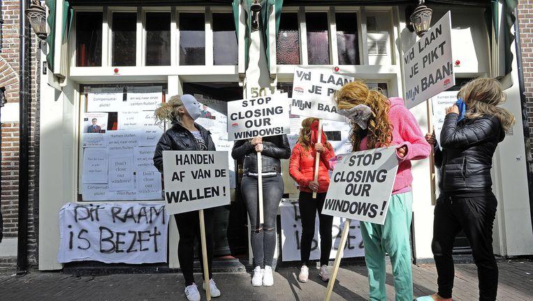 Protesterende prostituees vanochtend in Amsterdam. Beeld anp
