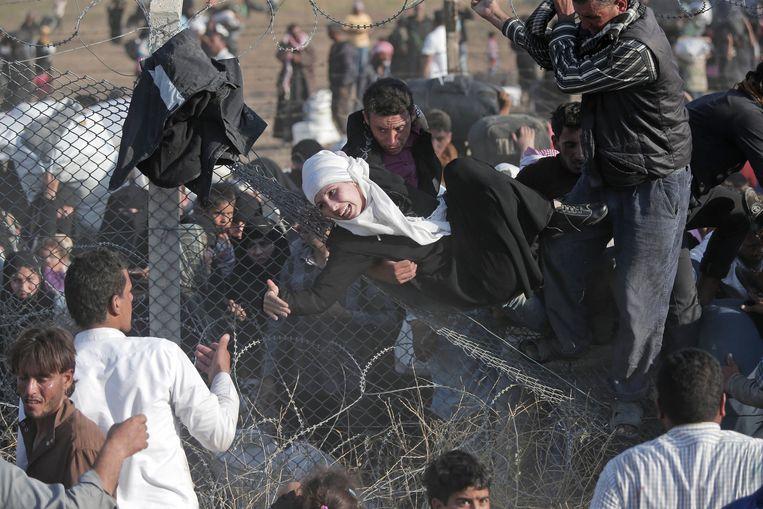 Syrische vluchtelingen aan de grens met Turkije. Beeld ap