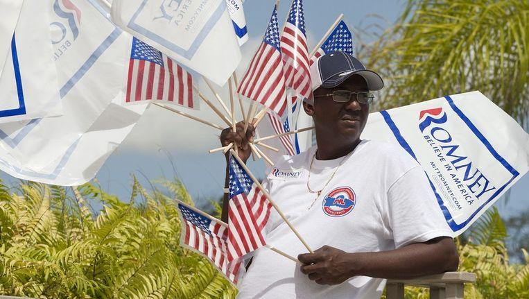 Een aanhanger van Mitt Romney gisteren op Puerto Rico. Beeld reuters