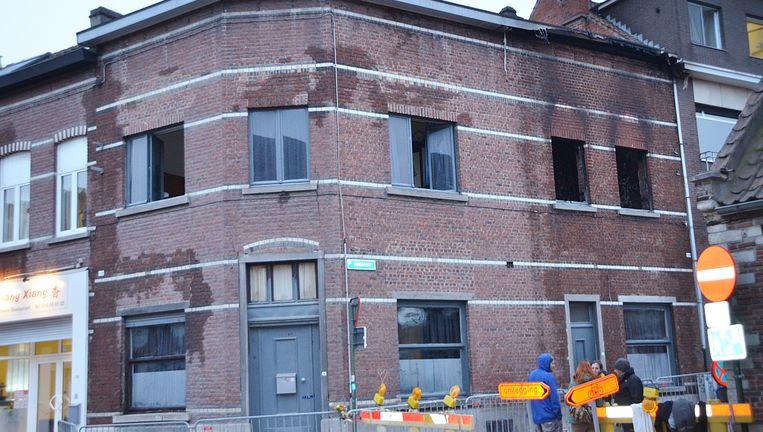Het uitgebrande pand in Leuven waar twee Ierse studentes om het leven kwamen. Beeld BELGA