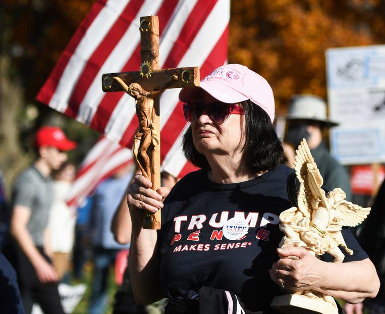 Het blinde geloof is vergelijkbaar met religieus fanatisme. Beeld AP