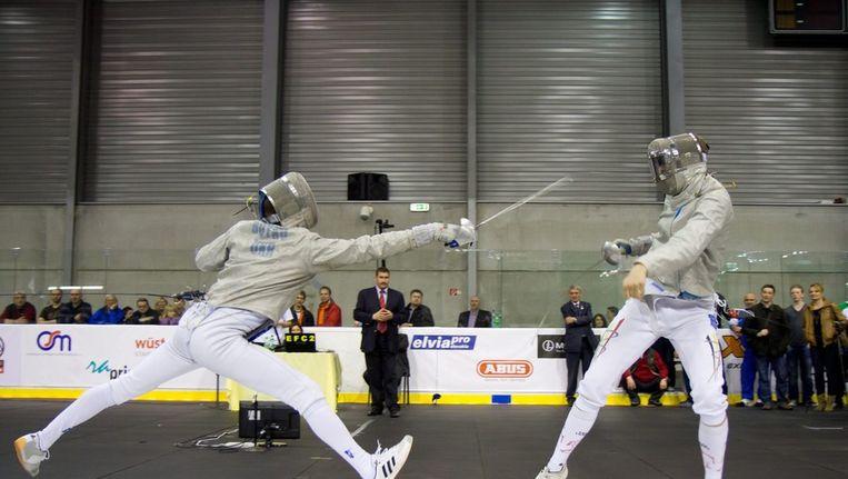 Seppe Van Holsbeke (rechts) moest de duimen leggen tegen Dmytro Boyko. Beeld EPA