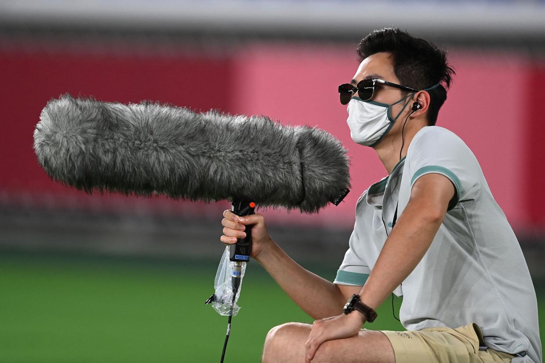 De microfoons langs de baan waren nooit eerder zo dichtbij als in Tokio. Beeld AFP
