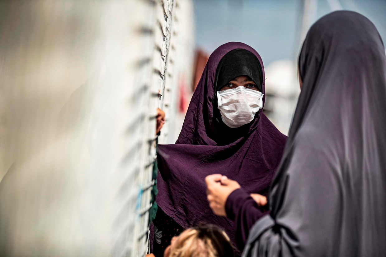 Vrouwen in Kamp Roj in Noord-Oost-Syrië. Beeld AFP
