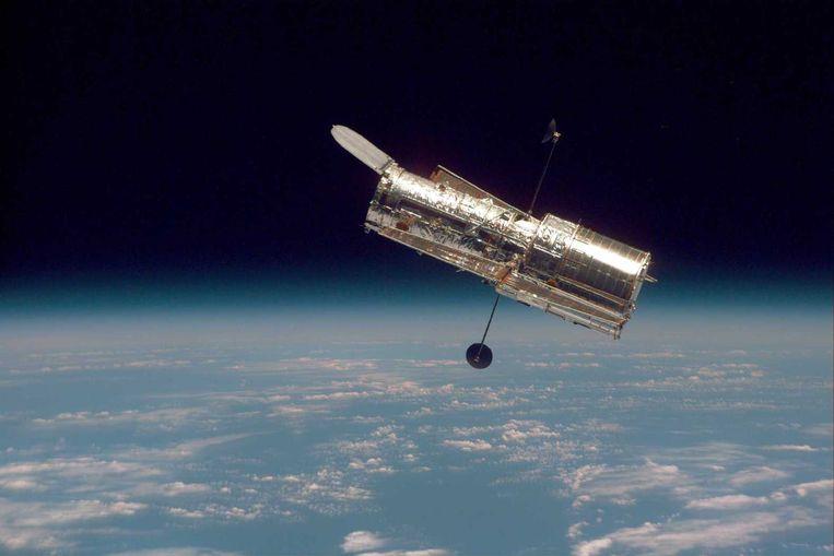De Hubble-telescoop, die sinds 1990 rond de aarde cirkelt. Beeld Nasa
