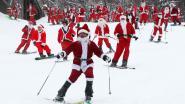 Honderden kerstmannen roetsjen van berg voor het goede doel