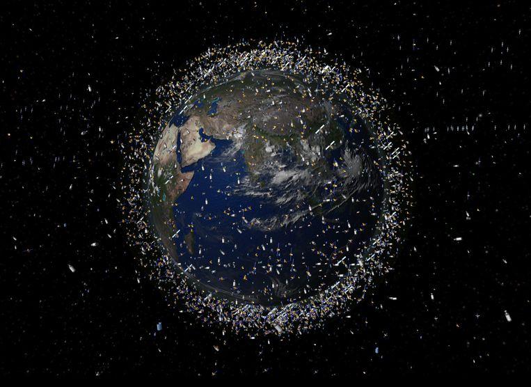 Impressie van de afvalwolk die de aarde omgeeft. Het puin is groter weergegeven dan het in werkelijkheid is.  Beeld ESA