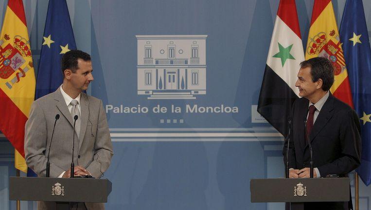 De Syrische president Al-Assad en de Spaanse premier Zapatero in juli vorig jaar, tijdens een bezoek van Al-Assad aan Spanje. Beeld