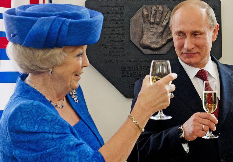 Koningin Beatrix en de Russische president Vladimir Poetin heffen het glas Beeld ANP