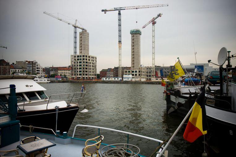 Een van de huidige projecten van Land Invest: de nieuwe woontorens op het Eilandje in Antwerpen.   Beeld Jimmy Kets