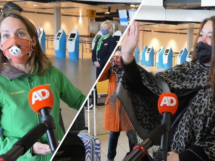 Eerste proefvakantiegangers in opperbeste stemming op Schiphol