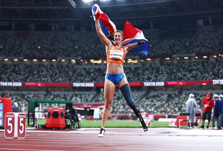 Marlène van Gansewinkel juicht na het winnen van de 100 meter. Beeld Reuters