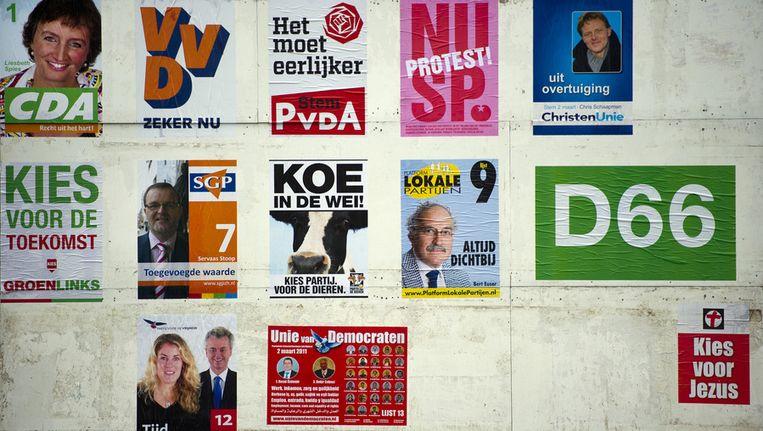 Verkiezingsposters van diverse politieke partijen. Beeld ANP