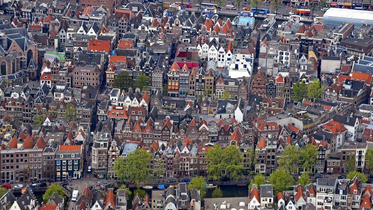 Aan de Amsterdamse grachten... Beeld Raymond Rutting / de Volkskrant