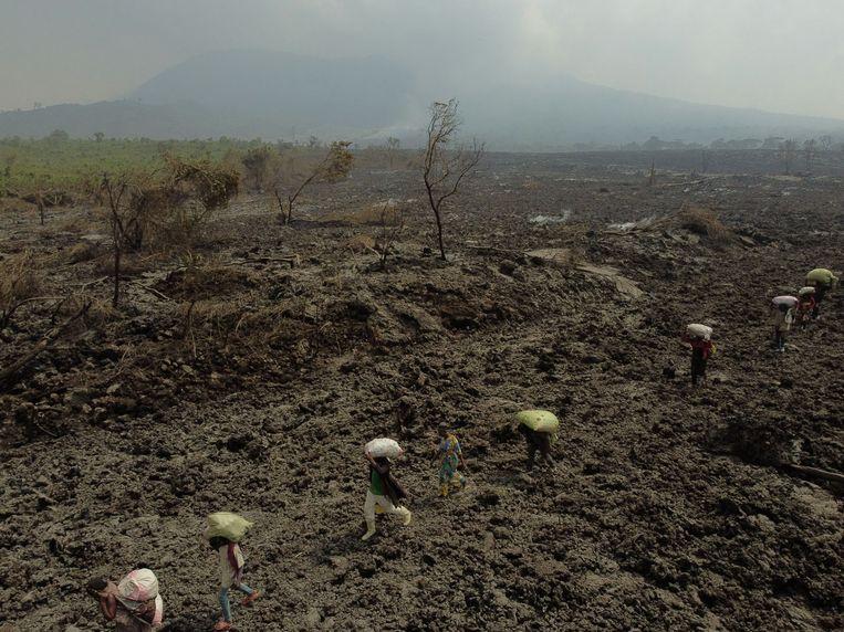 Mensen ontvluchtten de voorbije dagen het gebied in Goma. Beeld via REUTERS