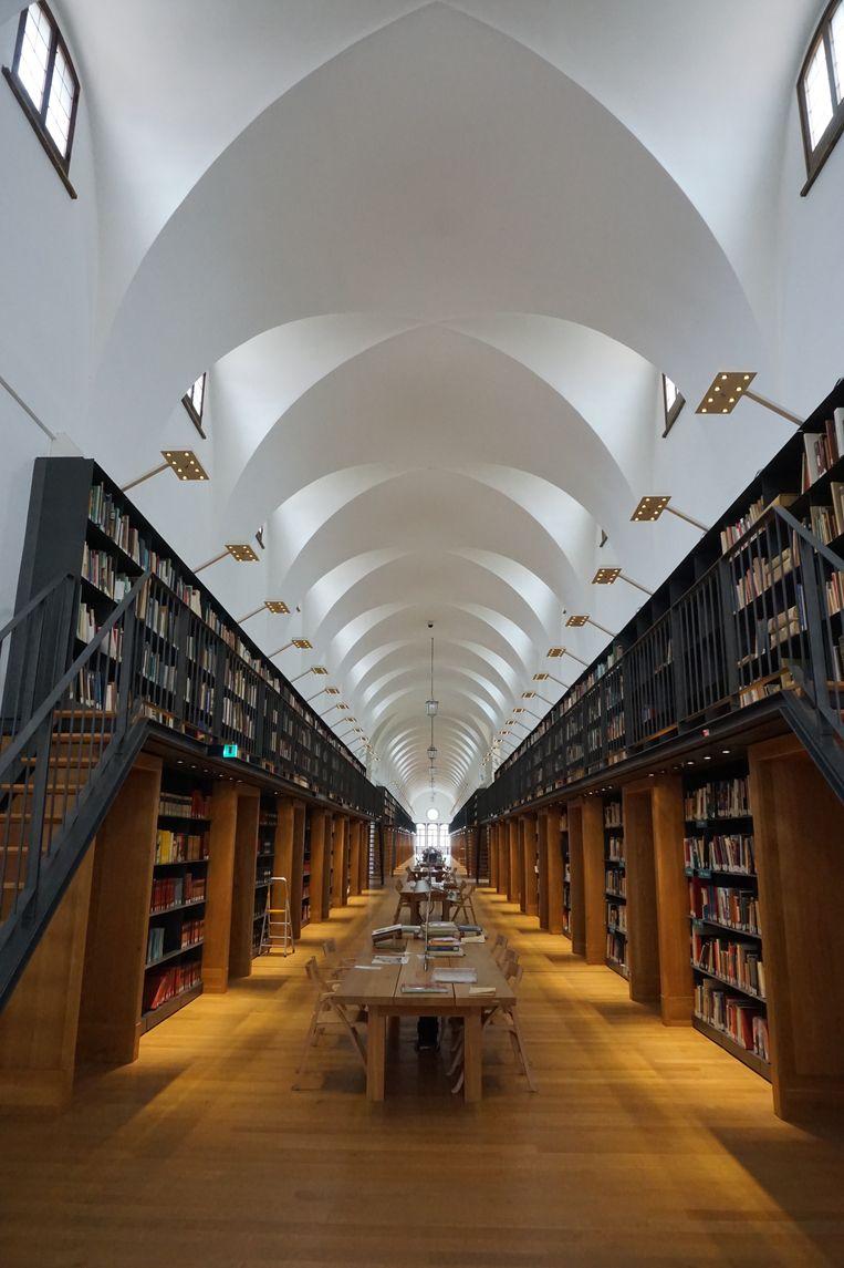 De nieuwe bibliotheek in de Fondazione Giorgio Cini was vroeger de slaapzaal van de monniken. Beeld Jef Mertens/The Venice Insider