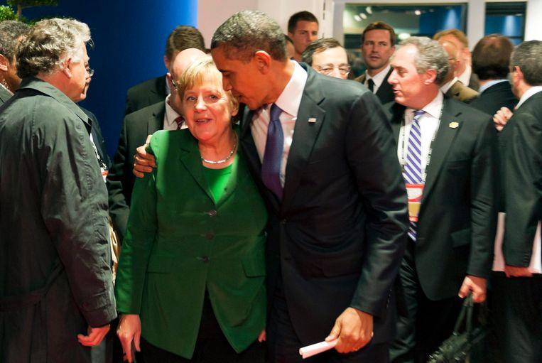 Merkel en Obama tijdens de economische G20-top in Cannes in 2011. Beeld Getty Images
