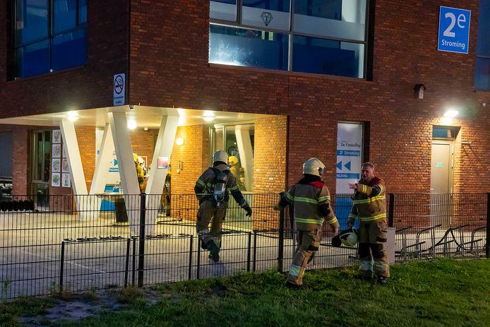Brandweerlieden aan het werk in Berghem.