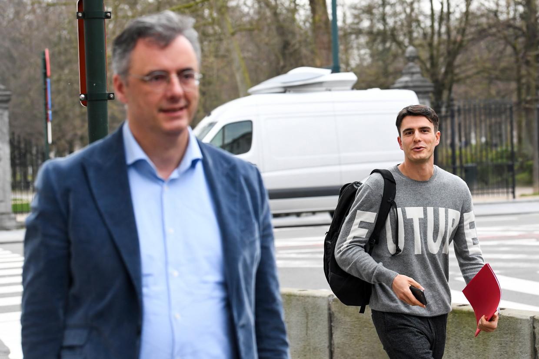 CD&V-voorzitter Joachim Coens en sp.a-voorzitter Conner Rousseau. Maken zij straks deel uit van een minderheidsregering? Beeld Photo News