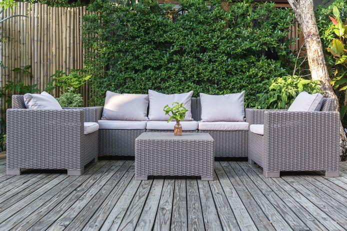 Large terrace patio with rattan garden furniture in the garden on wooden floor