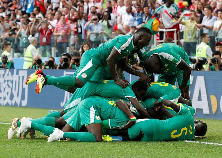 Na de nederlagen van Egypte, Marokko, Nigeria en Tunesië in hun eerste wedstrijden, boekte Senegal maandag een verrassende triomf op Polen Beeld Photo News