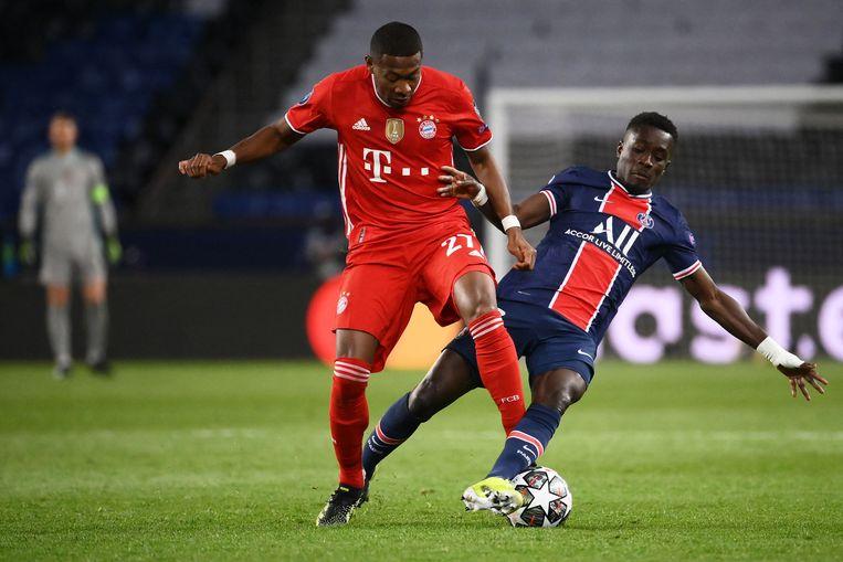 Idrissa Gueye (r) in duel met David Alaba. Beeld AFP