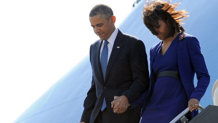 Barack en Michelle Obama bij aankomst in Boston. Beeld afp