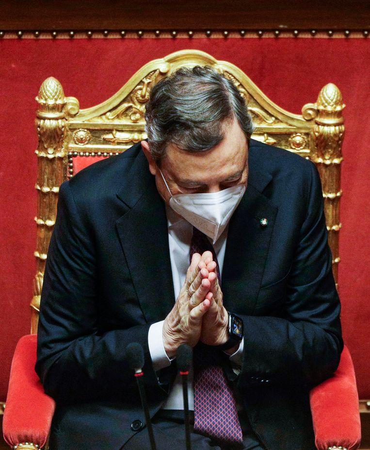 Italiaanse premier Mario Draghi presenteert de herstelplannen van zijn regering.  Beeld AFP