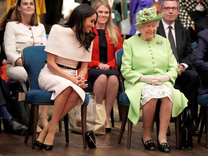 Queen Elizabeth II en Meghan in betere tijden.