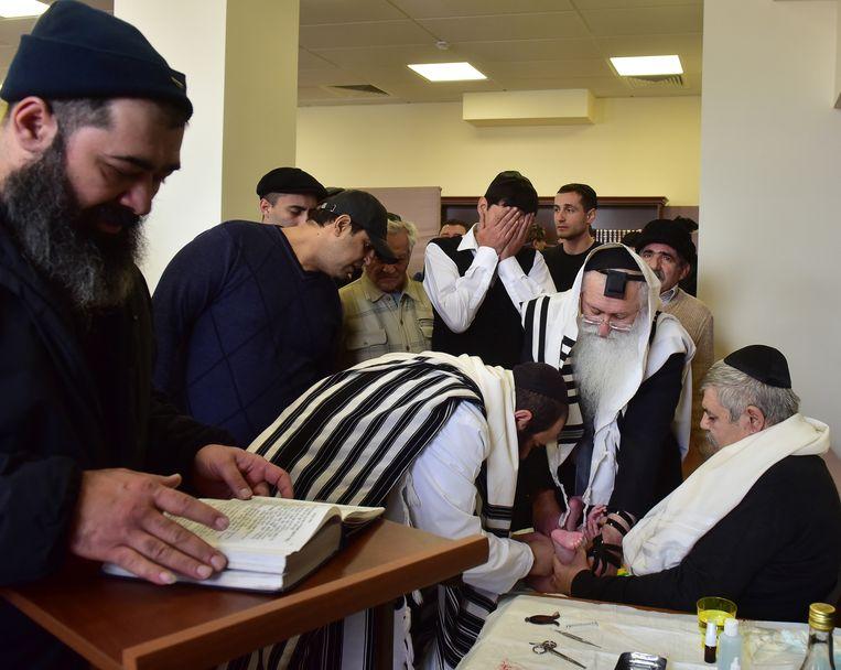 Een besnijdenis van een joodse baby. Beeld Anton Podgaiko/TASS